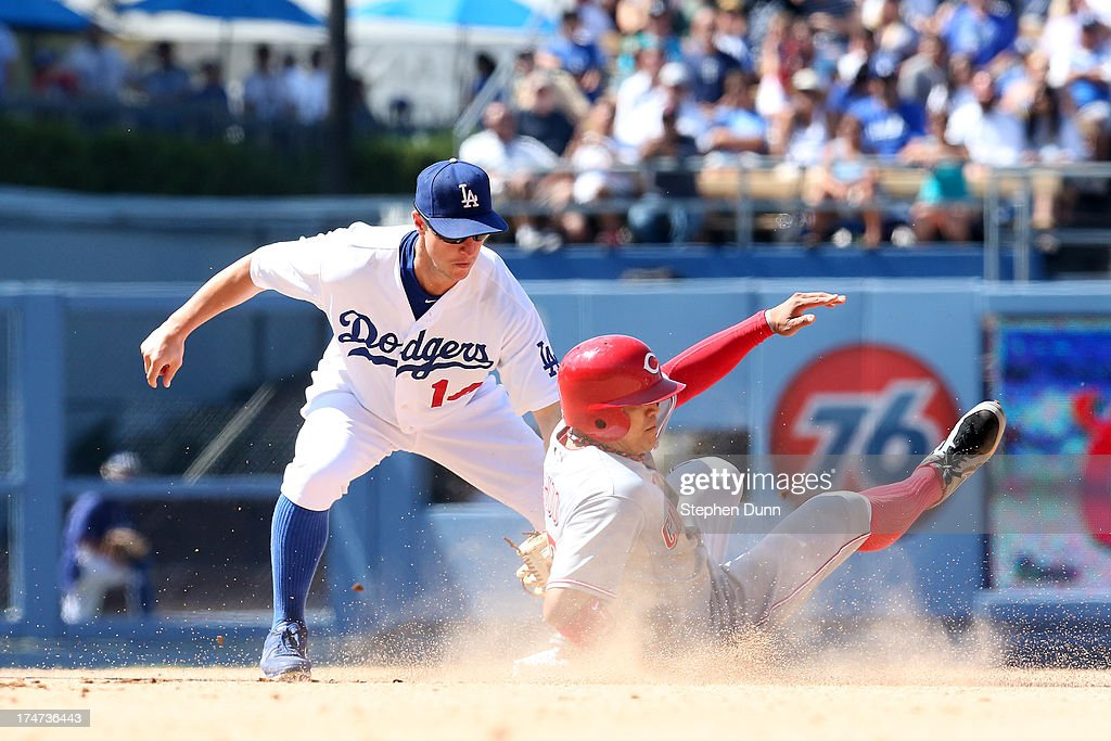 Shin-Soo Choo #17 of the Cincinnati Reds slides into second with a stolen base ahead of the tag by second Mark Ellis #14 of the Los Angeles Dodgersin thei eghth inning at Dodger Stadium on July 28, 2013 in Los Angeles, California.