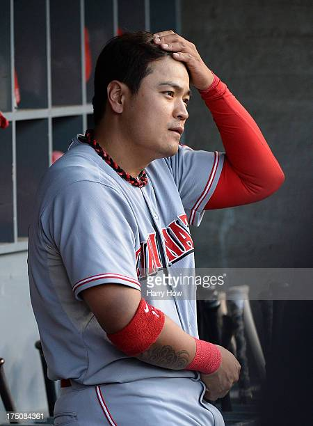 ShinSoo Choo of the Cincinnati Reds watches play from the dugout during the game against the Los Angeles Dodgers at Dodger Stadium on July 27 2013 in...