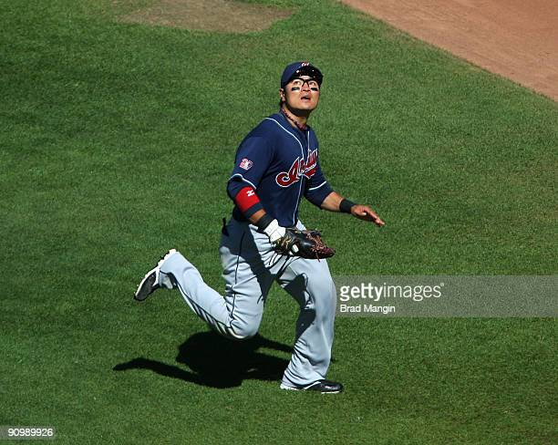 ShinSoo Choo of the Cleveland Indians chases a fly ball in right field against the Oakland Athletics during the game at the OaklandAlameda County...