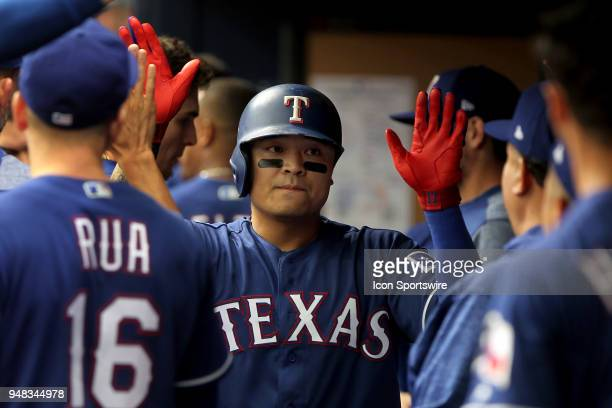ShinSoo Choo of the Rangers is congratulated by his teammates after his home run during the MLB regular season game between the Texas Rangers and the...