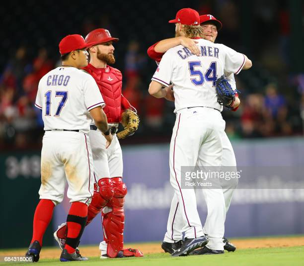 ShinSoo Choo of the Texas Rangers and Jonathan Lucroy looks on as Andrew Cashner congratulates Austin BibensDirkx for his first major league start...