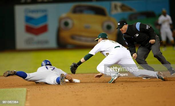 ShinSoo Choo of the Texas Rangers beats the tag at second by Jed Lowrie of the Oakland Athletics during the game at the Oakland Alameda Coliseum on...