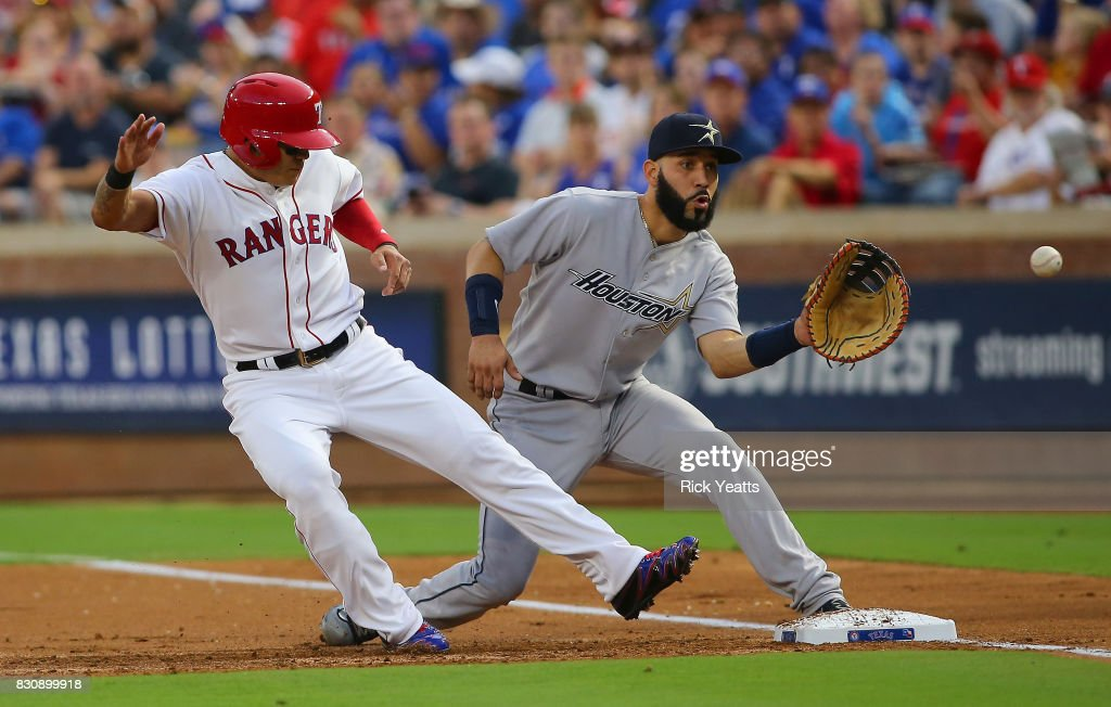 Shin-Soo Choo #17 of the Texas Rangers beats the tat on first base against Marwin Gonzalez #9 of the Houston Astroscat Globe Life Park in Arlington on August 12, 2017 in Arlington, Texas.