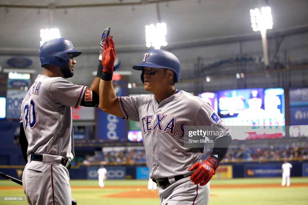 Shin-Soo Choo #17 of the Texas Rangers celebrate with teammate Nomar Mazara #30 after hitting a two-run home run off of pitcher Alex Cobb of the Tampa Bay Rays during the ninth inning of a game on July 21, 2017 at Tropicana Field in St. Petersburg, Florida.