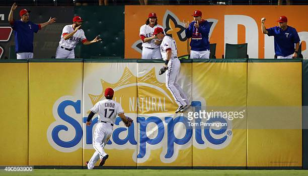 ShinSoo Choo of the Texas Rangers celebrates as Drew Stubbs of the Texas Rangers fields a fly ball for the final out in the top of the ninth inning...