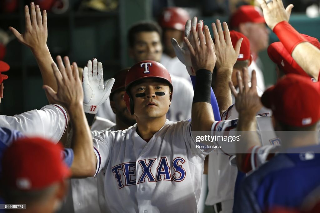 Shin-Soo Choo #17 of the Texas Rangers celebrates with teammates after scoring a run against the New York Yankees during the fifth inning of the Texas Rangers at Globe Life Park in Arlington on September 8, 2017 in Arlington, Texas.