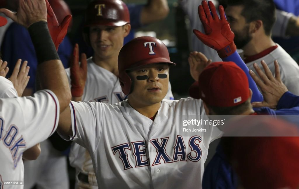 Shin-Soo Choo #17 of the Texas Rangers celebrates with teammates after hitting a two-run home run against the Oakland Athletics during the fifth inning at Globe Life Park in Arlington on September 29, 2017 in Arlington, Texas.
