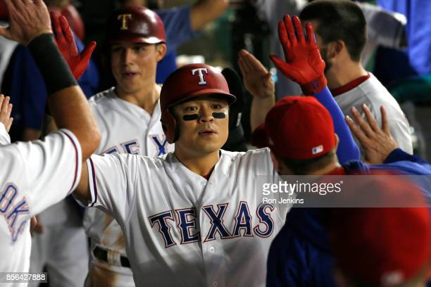 ShinSoo Choo of the Texas Rangers celebrates with teammates after hitting a tworun home run against the Oakland Athletics during the fifth inning at...