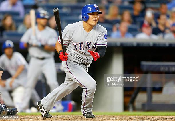 ShinSoo Choo of the Texas Rangers follows through on a thirdinning double against the New York Yankees at Yankee Stadium on June 27 2016 in the Bronx...
