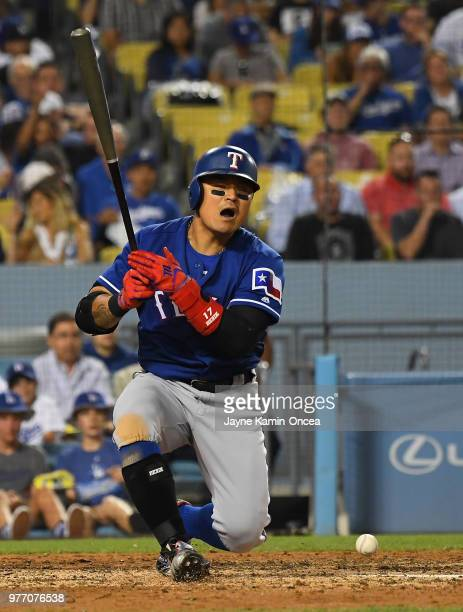 ShinSoo Choo of the Texas Rangers fouls a ball off his leg in the game against the Los Angeles Dodgers at Dodger Stadium on June 13 2018 in Los...