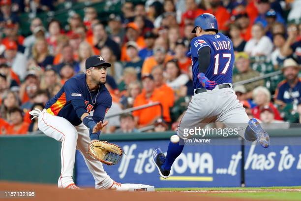 Shin-Soo Choo of the Texas Rangers grounds out as Yuli Gurriel of the Houston Astros fields the throw in the first inning at Minute Maid Park on July...