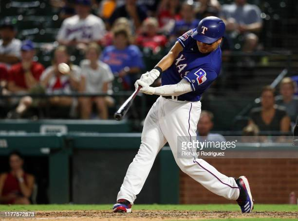 ShinSoo Choo of the Texas Rangers hits a home run against the New York Yankees in the ninth inning at Globe Life Park in Arlington on September 27...