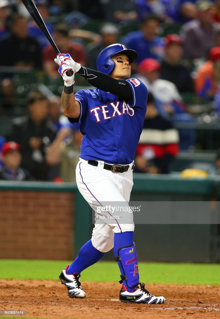 Shin-Soo Choo #17 of the Texas Rangers hits a home run in the sixth inning against the Toronto Blue Jays at Globe Life Park in Arlington on April 6, 2018 in Arlington, Texas.
