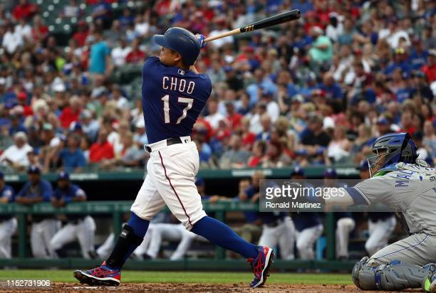 ShinSoo Choo of the Texas Rangers hits a homerun in the third inning against the Kansas City Royals at Globe Life Park in Arlington on May 30 2019 in...