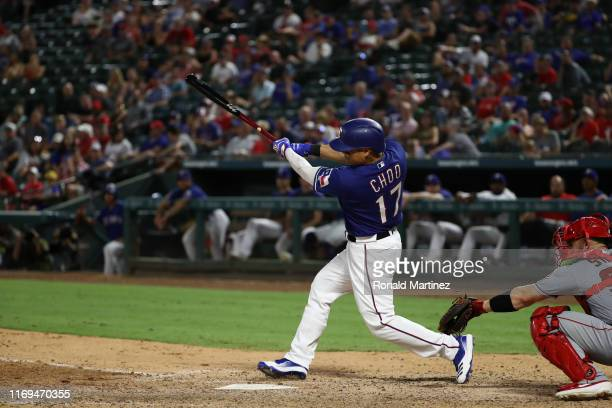 ShinSoo Choo of the Texas Rangers hits a one run single against the Los Angeles Angels at Globe Life Park in Arlington on August 21 2019 in Arlington...