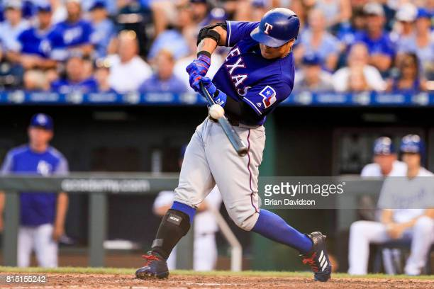 ShinSoo Choo of the Texas Rangers hits a RBI to drive in Joey Gallo to score against the Kansas City Royals during the ninth inning at Kauffman...