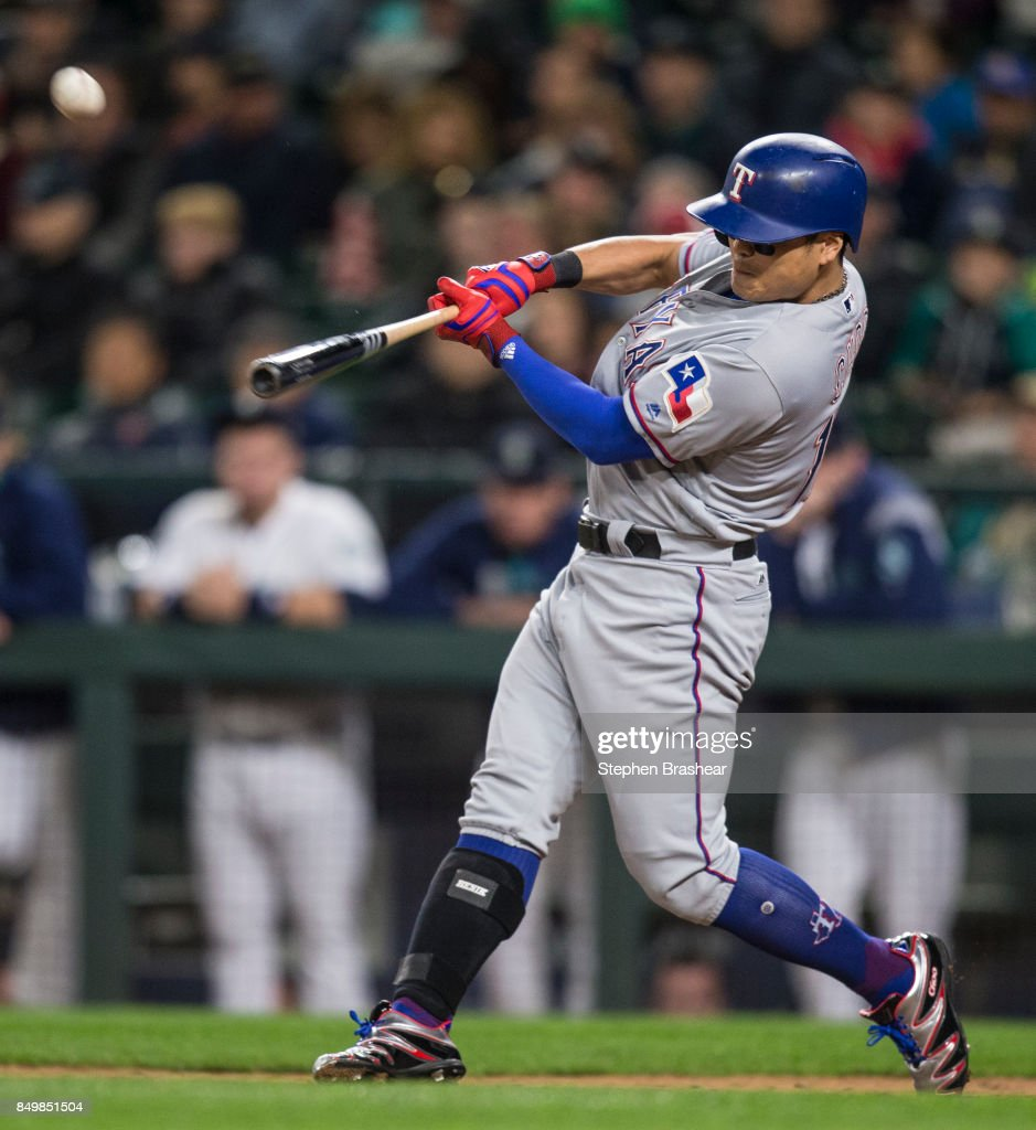 Shin-Soo Choo #17 of the Texas Rangers hits a sacrifice fly off of relief pitcher Nick Vincent #50 of the Seattle Mariners that scored Will Middlebrooks #15 of the Texas Rangers during the eighth inning of a game at Safeco Field on September 19, 2017 in Seattle, Washington.