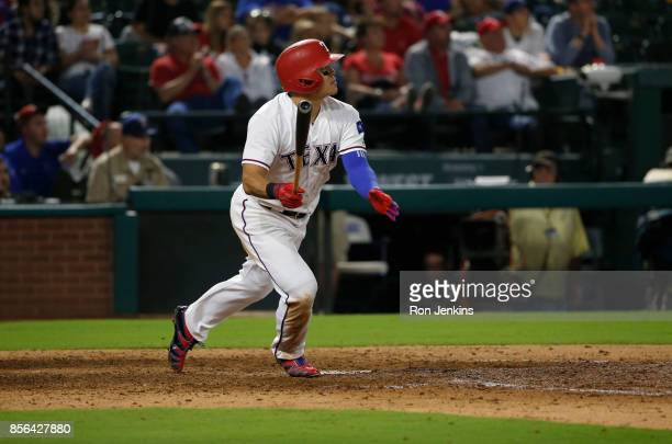ShinSoo Choo of the Texas Rangers hits a tworun home run against the Oakland Athletics during the fifth inning at Globe Life Park in Arlington on...