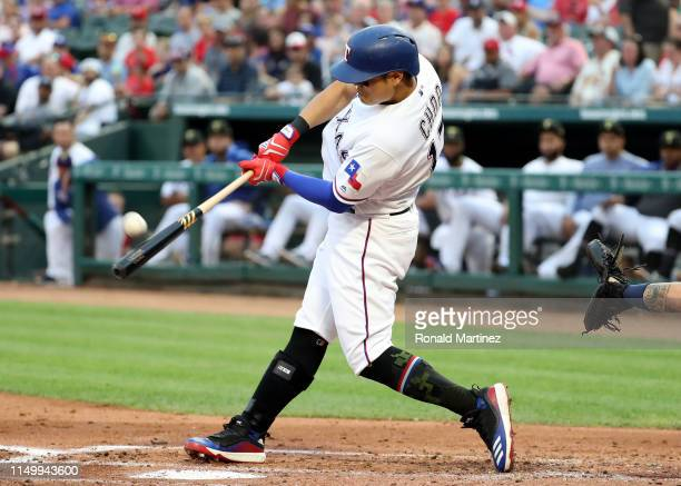 ShinSoo Choo of the Texas Rangers hits a tworun homerun against the St Louis Cardinals in the second inning at Globe Life Park in Arlington on May 17...