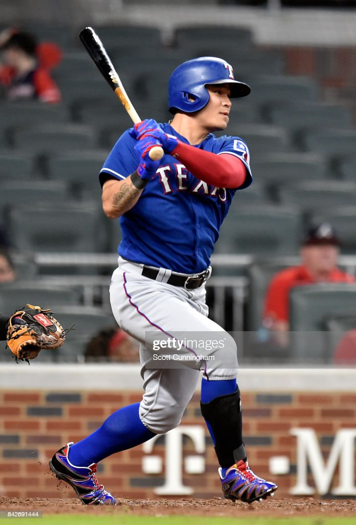 Shin-Soo Choo #17 of the Texas Rangers hits an eighth inning single against the Atlanta Braves at SunTrust Park on September 4, 2017 in Atlanta, Georgia.