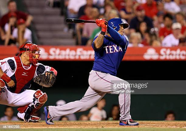 ShinSoo Choo of the Texas Rangers hits an RBI single in the seventh inning against the Los Angeles Angels of Anaheim at Angel Stadium of Anaheim on...