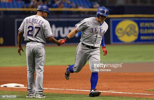 ShinSoo Choo of the Texas Rangers is congratulated after hitting a home run in the sixth inning during a game against the Tampa Bay Rays at Tropicana...