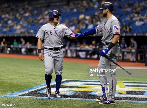 ShinSoo Choo of the Texas Rangers is congratulated after scoring a run in the first inning by Joey Gallo during a game against the Tampa Bay Rays at...