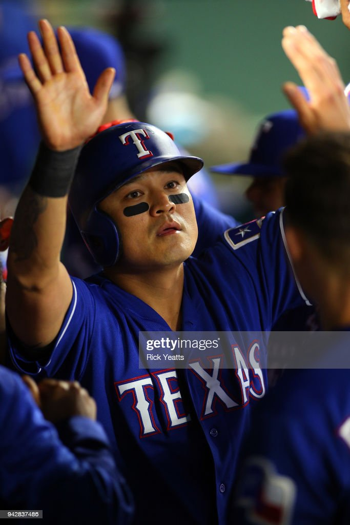 Shin-Soo Choo #17 of the Texas Rangers is congratulated for scoring in the seventh inning against the Toronto Blue Jays at Globe Life Park in Arlington on April 6, 2018 in Arlington, Texas.