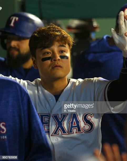 ShinSoo Choo of the Texas Rangers is congratulated for scoring in the in the third inning against the Seattle Mariners at Globe Life Park in...