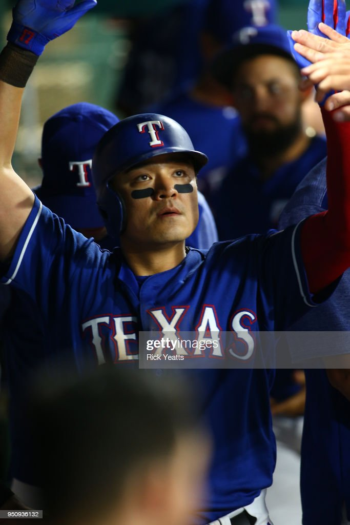 Shin-Soo Choo #17 of the Texas Rangers is congratulated for scoring in the eighth inning against the Oakland Athletics at Globe Life Park in Arlington on April 24, 2018 in Arlington, Texas.