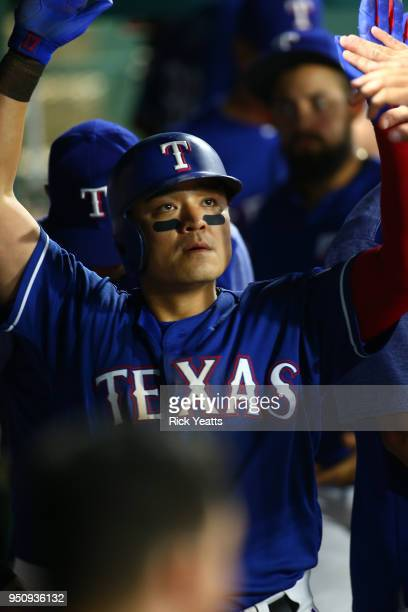 ShinSoo Choo of the Texas Rangers is congratulated for scoring in the eighth inning against the Oakland Athletics at Globe Life Park in Arlington on...