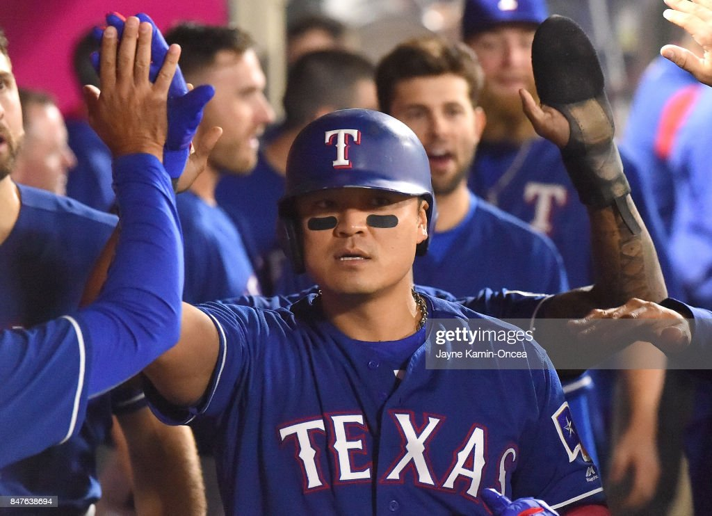 Shin-Soo Choo #17 of the Texas Rangers is greeted in the dugout after hitting a two run home run in the fifth inning of the game against the Los Angeles Angels of Anaheim at Angel Stadium of Anaheim on September 15, 2017 in Anaheim, California.