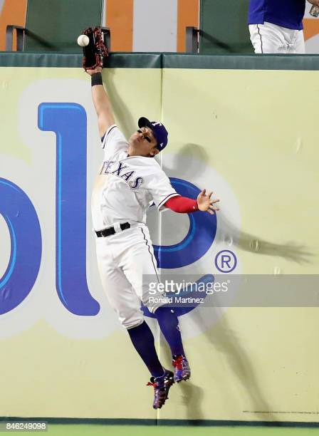 ShinSoo Choo of the Texas Rangers jumps for the double hit by Robinson Cano of the Seattle Mariners in the sixth inning at Globe Life Park in...