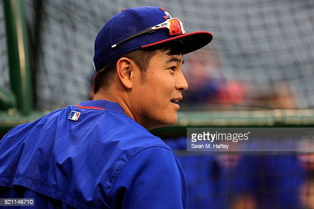 ShinSoo Choo of the Texas Rangers looks on during batting practice prior to a baseball game between the Los Angeles Angels of Anaheim and Texas...