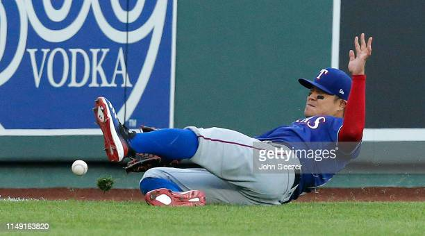 ShinSoo Choo of the Texas Rangers misses on an RBI double off the bat of Alex Gordon of the Kansas City Royals in the first inning during the game at...
