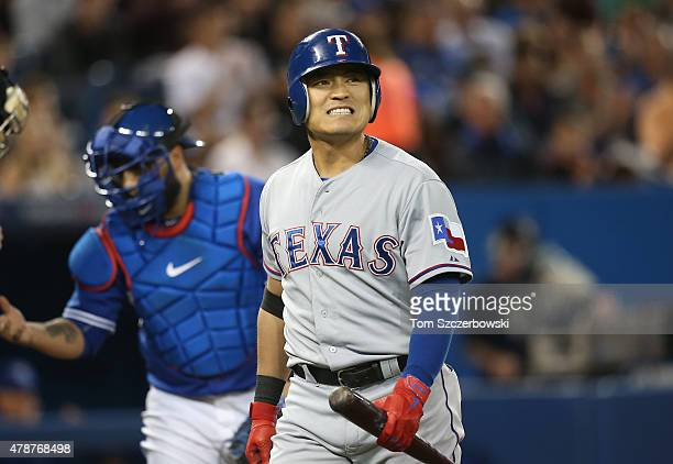 ShinSoo Choo of the Texas Rangers reacts after striking out in the first inning during MLB game action against the Toronto Blue Jays on June 27 2015...