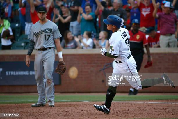 Shin-Soo Choo of the Texas Rangers rounds the bases after hitting the game winning home run as Hunter Dozier of the Kansas City Royals looks on...