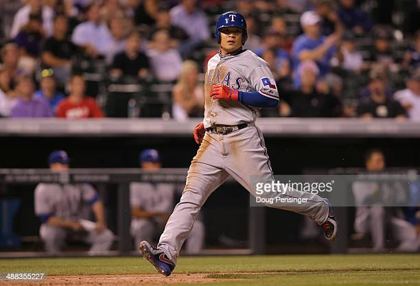 ShinSoo Choo of the Texas Rangers runs home to score on a ground out by Josh Wilson of the Texas Rangers off of starting pitcher Jordan Lyles of the...