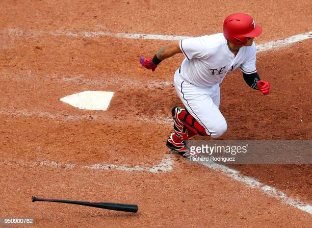 ShinSoo Choo of the Texas Rangers runs to first base after hitting a single in the fifth inning against the Seattle Mariners at Globe Life Park in...