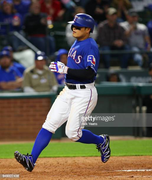 ShinSoo Choo of the Texas Rangers scores in the sixth inning against the Seattle Mariners at Globe Life Park in Arlington on April 20 2018 in...