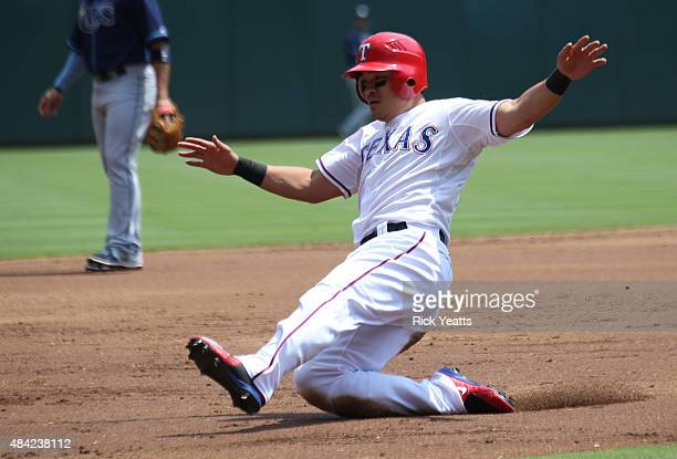 ShinSoo Choo of the Texas Rangers slides safe to third base on a line out by Prince Fielder against the Tampa Bay Rays at Global Life Park in...