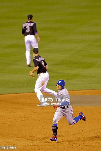 ShinSoo Choo of the Texas Rangers strides to third base with a triple to complete the cycle in the ninth inning as DJ LeMahieu and Daniel Descalso of...