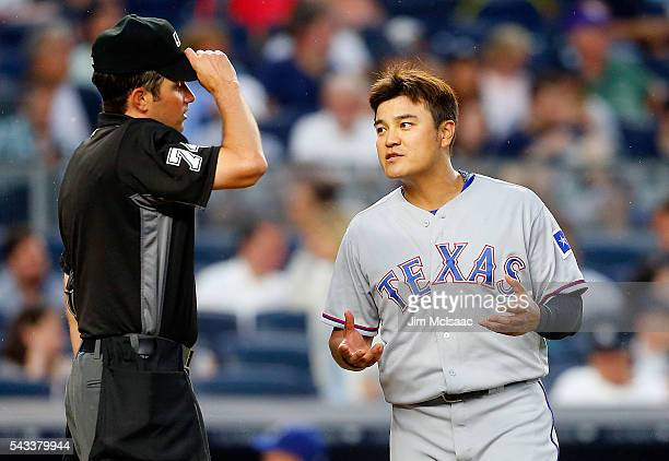 ShinSoo Choo of the Texas Rangers talks with home plate umpire John Tumpane after the third inning against the New York Yankees at Yankee Stadium on...