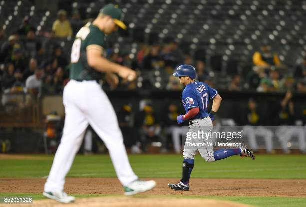 ShinSoo Choo of the Texas Rangers trots around the bases after hitting a solo home run off of Kendall Graveman of the Oakland Athletics in the top of...