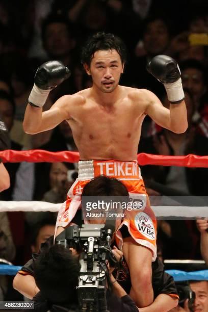 Shinsuke Yamanaka of Japan celebrates after victory over Stephane Jamoye of Belgium to defend his title during the WBC bantamweight title bout...