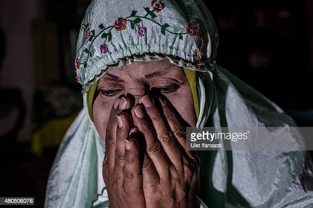 Shinta Ratri, a leader of a Pesantren boarding school, Al-Fatah, for transgender people known as 'waria' prays during Ramadan on July 08, 2015 in...