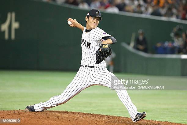 Shintaro Fujinami of Japan pitches during the international friendly match between Japan and Netherlands at the Tokyo Dome on November 12 2016 in...
