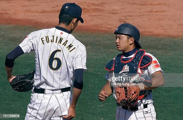 Shintaro Fujinami of Japan talks with Tomoya Mori during the 18U Baseball World Championship match between Japan and Colombia at Mokdong Stadium on...