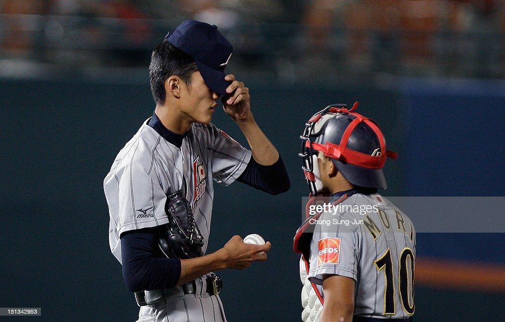 Shintaro Fujinami of Japan talks with Tomoya Mori in the seventh inning during the 18U Baseball World Championship match between Japan and South Korea at Mokdong Stadium on September 6, 2012 in Seoul, South Korea.