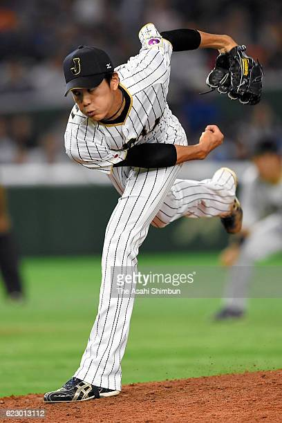 Shintaro Fujinami of Japan throws during the international friendly match between Japan and Netherlands at the Tokyo Dome on November 12 2016 in...